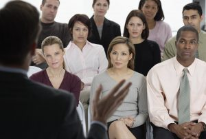 Employees Listening to Presentation the non verbal elements of personal impact